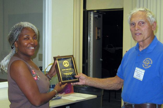 Rhonda Robb Baber receiving her plaque for 15 years of service